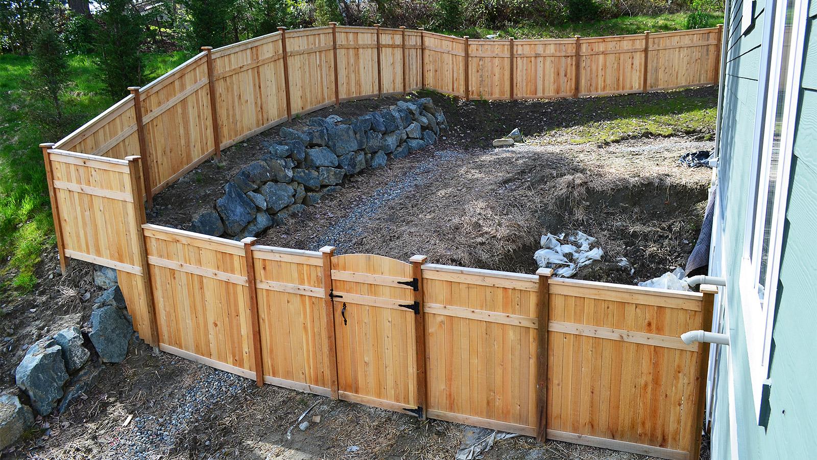 Triple Rail Cedar Panel Fence with Cap and Trim